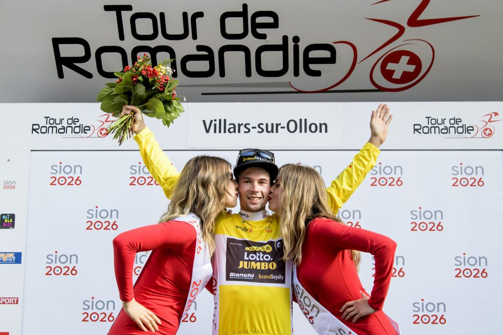 The overall leader Primoz Roglic from Slovenia of team Lotto NL-Jumbo celebrates on the podium with the yellow jersey during the third stage, a 9,9 km race against the clock between Ollon and Villars during the 72th Tour de Romandie UCI ProTour cycling race in Villars, Switzerland, Friday, April 27, 2018. (Jean-Christophe Bott/Keystone via AP)