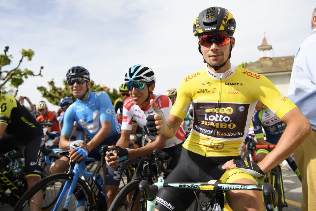 The overall leader Primoz Roglic from Slovenia of team Lotto NL-Jumbo poses with the yellow jersey before the fifth and last stage, a 181,8 km race between Mont-sur-Rolle and Geneva during the 72th Tour de Romandie UCI ProTour cycling race in Mont-sur-Rolle, Switzerland, Sunday, April 29, 2018. (Jean-Christophe Bott/Keystone via AP)