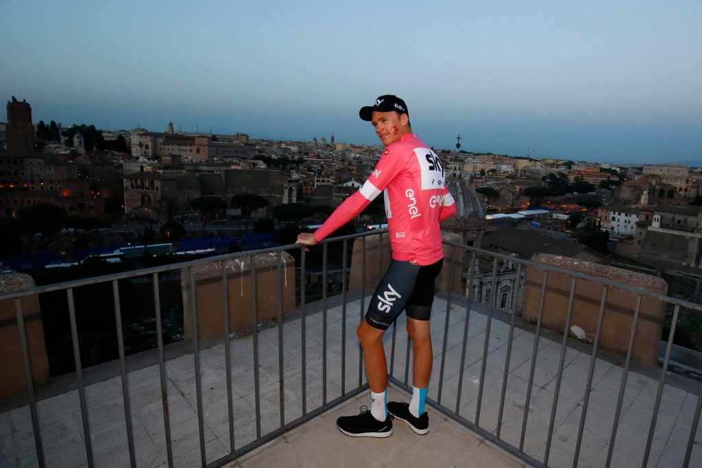 Pink jersey and winner Britain's rider of team Sky Christopher Froome poses on a terrace overlooking the Imperial Fora after the 21st and last stage of the 101st Giro d'Italia, Tour of Italy cycling race, on May 27, 2018 in Rome. Britain's Chris Froome completed a sensational comeback to win the Giro d'Italia on Sunday for a rare Grand Tour treble after the 21st and final stage in Rome. Froome, 33, became the first Briton to win the race in the Giro's 101-year history after the 115km closed circuit race through the streets of the Italian capital. / AFP PHOTO / LUK BENIES
