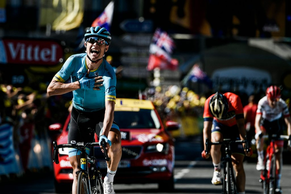 Denmark's Magnus Nielsen (L) celebrates as he crosses the finish line to win, ahead of Spain's Jon Izagirre (2ndR) and Netherlands' Bauke Mollema (Rear R) the 15th stage of the 105th edition of the Tour de France cycling race, between Millau and Carcassonne on July 22, 2018. / AFP PHOTO / Philippe LOPEZ
