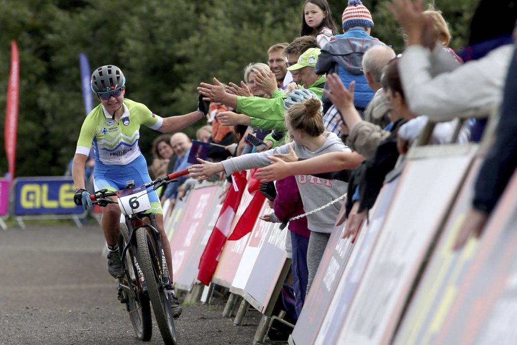 Slovenia's Tanja Zakelj is greeted by the crowd as she crosses the finish of the Womens Cross Country event during the European Championships at the Cathkin Braes Mountain Bike Trails, near Glasgow, Scotland, Tuesday Aug. 7, 2018. (Jane Barlow/PA via AP)